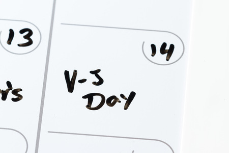 vj: close up of a daily planner or calendar with a hand written message for a celebration or holiday Stock Photo