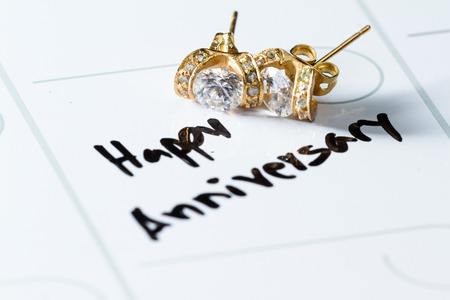 written date: close up of a daily planner or calendar with a hand written to remember a special date like an anniversary