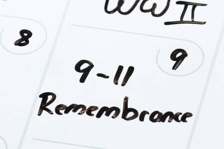 9 11: close up of a daily planner or calendar with a hand written message for a celebration or holiday like 9 11 remembrance