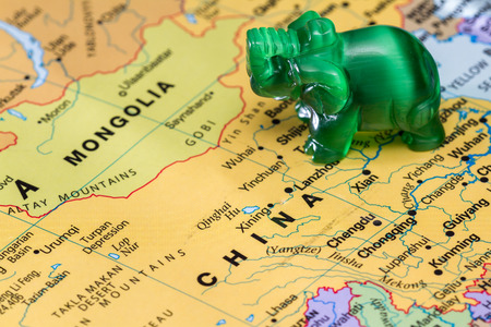 View of a world map with a small elephant in asia as a concept stock stock photo view of a world map with a small elephant in asia as a concept gumiabroncs