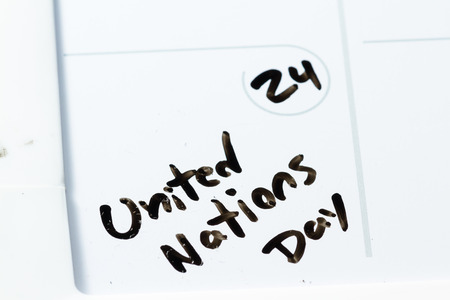 onu: close up of a daily planner or calendar with a hand written message for a celebration or holiday Stock Photo