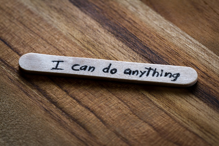 provoking: close up of a hand written message on a ice cream stick as a self esteem building concept