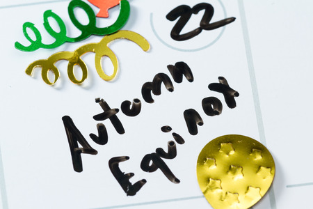 equinox: close up of a daily planner or calendar with a hand written message for a celebration or holiday Stock Photo