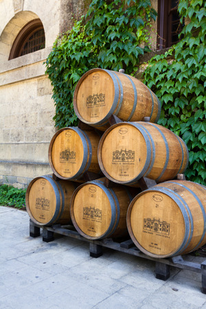 famous industries: Calistoga, California - May 10 : Wine barrels stacked outside of the Chateau Montelena, May 10 2015 Calistoga, California.