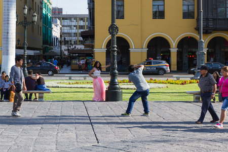 fifteen year old: Lima - May 10 : Quinceanera getting professional photographs in the Plaza Mayor de Armas in Lima. May 10 2016 Lima Peru.