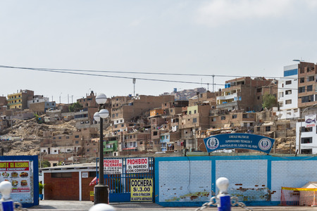 low income housing: Lima, Peru - May 10 : Living accommodations or urban jungle near the ruins of Pachacamac in Lima, Peru. May 10 2016 Lima, Peru. Editorial