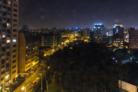 Lima Peru - May 09 : View of the city at night with a glare effect from the Dazzler Lima hotel room window, Lima. May 09 2016 Miraflores, Lima Peru.