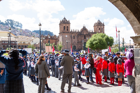 civic: Cusco, Peru - May 12 : School children in uniform in a civic parade celebrating National Independence, parade known as the swearing of the School Police. May 12 2016, Cusco Peru.
