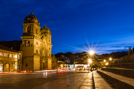 cusco: Cusco, Peru - May 13: Beautiful Cusco Cathedral photographed with a slow shutter to show motion in people and glowing lights. May 13 2016, Cusco Peru.
