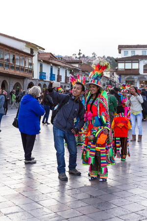 religious clothing: Cusco, Peru - May 13: young mother posing with her child dressed in beautiful colored clothing during a religious celebration. May 13 2016, Cusco Peru. Editorial