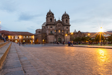 Cusco, Peru - May 13: Beautiful Cusco Cathedral photographed with a slow shutter to show motion in people and glowing lights. May 13 2016, Cusco Peru.