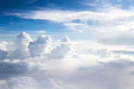 elevation: towering cloud formations viewed from an airplane window at a high elevation Stock Photo