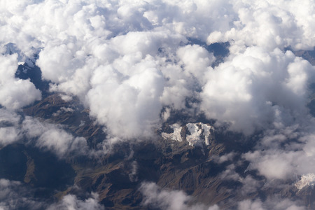 Peru - May 11 : Aerial view of the snow caped mountains of Peru from an Airplane flying from Lima to Cuzco. May 11 2016, Peru. Stock Photo