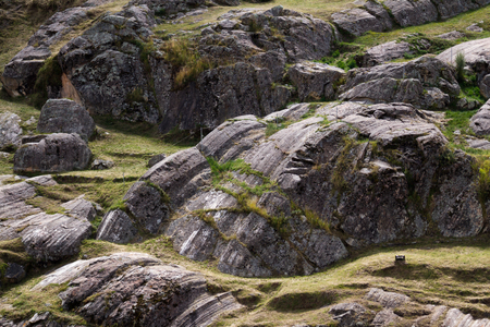 megalith: markings of what seems to be glacial erosion on the top of a mountain in Peru