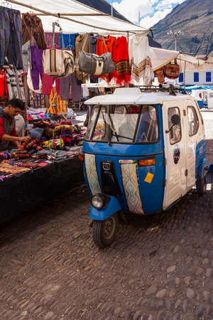 mototaxi: Pisac, Peru - May 15: MotoTaxi a small compact vehicle making its way thru the Pisac market. May 15 2016, Pisac Peru. Editorial