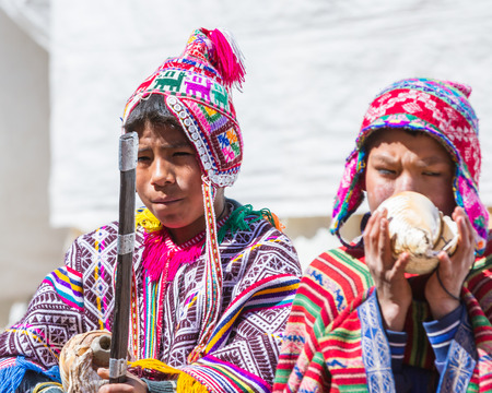 Pisac, Peru - May 15: Young man playing a tune using a conch shell as part of a ceremony in the Sacred Valley Market. May 15 2016, Pisac Peru. Editorial