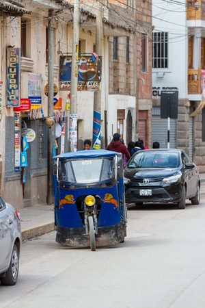 Pisac, Peru - May 15: MotoTaxi a small compact vehicle making its way thru the streets of Pisac. May 15 2016, Pisac Peru.