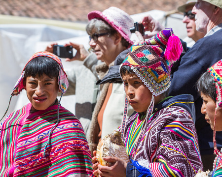 pisac: Pisac, Peru - May 15: Young man dressed in beautiful traditional clothing in the Pisac Market. May 15 2016, Pisac Peru.