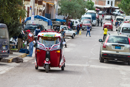 mototaxi: Pisac, Peru - May 15: MotoTaxi a small compact vehicle making its way thru the streets of Pisac. May 15 2016, Pisac Peru.