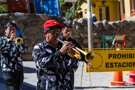 fiestas: Ollantaytambo, Peru - May 16 : Religious celebration for Fiestas de Pentecostes with musicians marching on the streets of Ollantaytambo. May 16 2016, Ollantaytambo Peru.