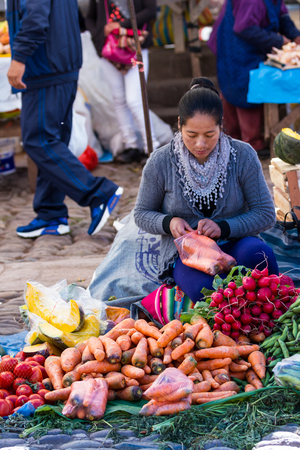 pisac: Pisac, Peru - May 15: Fresh produce for sale by native Quechua people at the Pisac Market. May 15 2016, Pisac Peru. Editorial