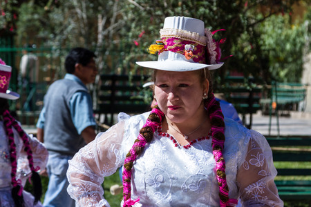 fiestas: Ollantaytambo, Peru - May 16 : Religious celebration for Fiestas de Pentecostes with people wearing masks and colorful clothing on the streets of Ollantaytambo. May 16 2016, Ollantaytambo Peru.