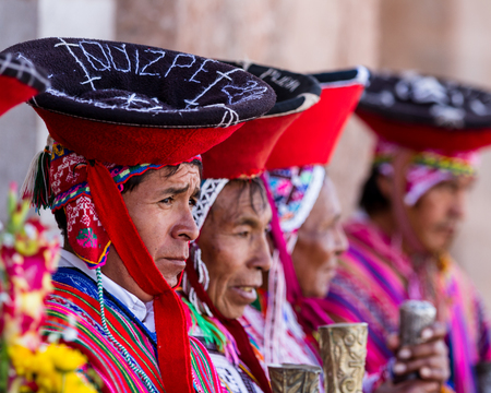 Pisac, Peru - May 15: Quechua elders in traditional clothing in a small ceremony in the Pisac Market. May 15 2016, Pisac Peru. Editorial