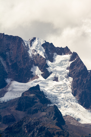 andes mountain: Close up of a large mountain in the Peruvian Andes with snow pack