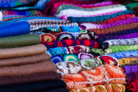 textiles in multiple colors made by hand by the weavers in Chinchero Peru
