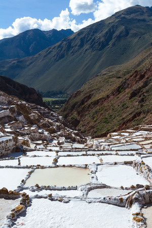 sacred valley of the incas: Salt ponds in Maras Peru covering a hillside with rich minerals and a economy boost for the country and people