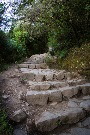 gradual: Stone path with steep inclines making its way to the top of Machu Pichu Stock Photo