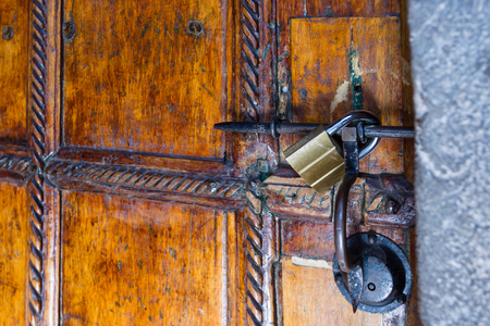 deatil: close up of an old door with a large keyhole in a Spanish colonial style
