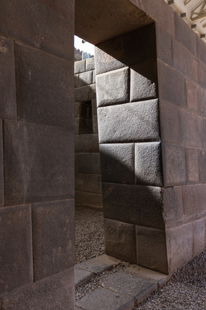 precisely: intriguing construction methods used by the incas using large blocks of stone stacked perfectly and precisely cut used here for the Sun Temple, Qurikancha. Stock Photo
