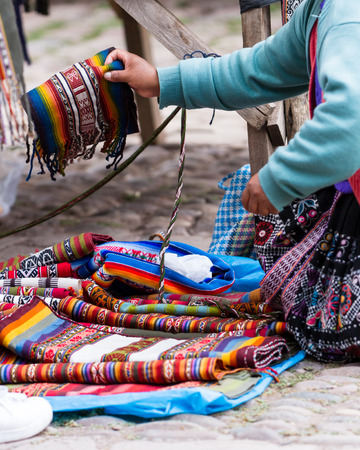 close up of traditional Peruvian textiles for sale in the market of Pisac