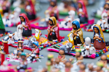 pisac: close up of a group of religious souvenirs for sale in the Market of Pisac