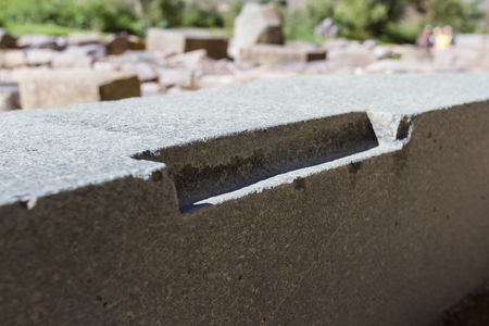 close up of the Inca stone work with precise cuts into solid stone that still makes us wonder how they did it Redakční