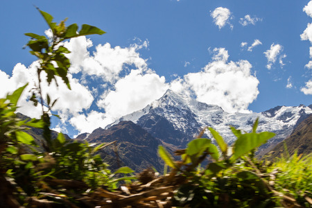 view of a beautiful mountain in Peru covered in snow with a blurry foreground caused by the moving train Stock Photo