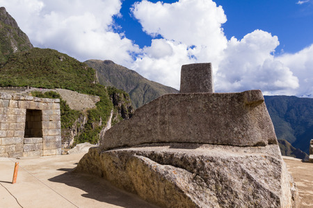 Machu Pichu, Peru - May 16 : Sun dial on top of the Inca Ruins of Machu Pichu. May 16 2016, Machu Pichu Peru.