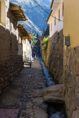 Living in Ollantaytambo Peru, a view down an alleyway built in traditional Inca style walls Stock Photo