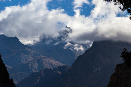 poking: Mountain landscape in Peru with tall peaks poking thru the clouds Stock Photo