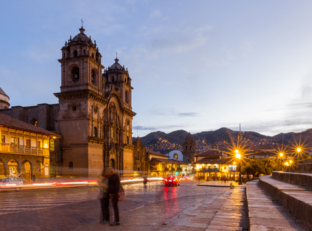 colonial church: Cusco, Peru - May 13: Beautiful Cusco Cathedral photographed with a slow shutter to show motion in people and glowing lights. May 13 2016, Cusco Peru.