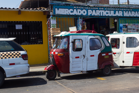 mototaxi: Lima Peru - May 11 : Moto-taxi parked in front of a convenience store, Lima. May 11 2016, Lima Peru.
