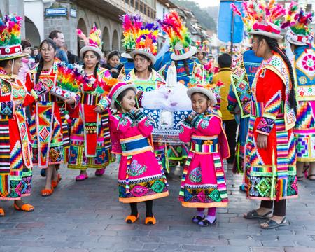 cusco: Cusco, Peru - May 13: Native people of Cusco dressed in colorful clothing in a religious celebration for Nuestra Señora de Fatima. May 13 2016, Cusco Peru.
