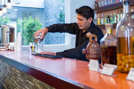 cusco: Cusco, Peru - May 13 : Bartender preparing a Cusco Sour in a beautiful bar downtown Cusco. May 13 2016, Cusco Peru. Editorial