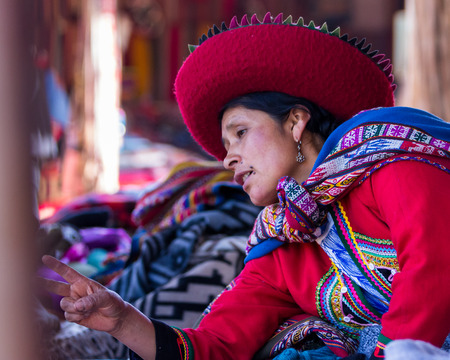 weavers: Chinchero Peru -May 18 : Lifestyle photograph of woman in chinchero selling products at the market. May 18 2016, Chinchero Peru.
