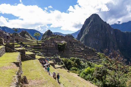 the lost city of the incas: Machu Pichu, Peru - May 16 : Tourists exploring the Lost City of the Incas or Machu Pichu, beautiful site in Peru. May 16 2016, Machu Pichu Peru. Editorial