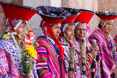 pisac: Pisac, Peru - May 15: Quechua elders in traditional clothing in a small ceremony in the Pisac Market. May 15 2016, Pisac Peru. Editorial