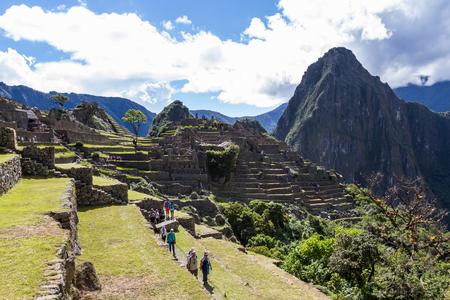 Machu Pichu, Peru - May 16 : Tourists exploring the Lost City of the Incas or Machu Pichu, beautiful site in Peru. May 16 2016, Machu Pichu Peru. Editorial