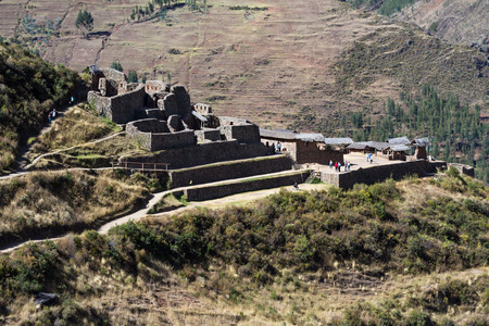 pisac: Pisac, Peru - May 15: Tourists walking and enjoying the amazing views of the Pisac Ruins. May 15 2016, Pisac Peru. Stock Photo