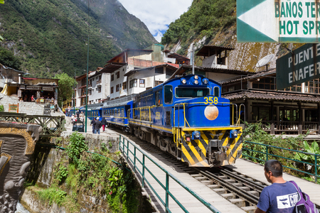 goods train: Machu Pichu, Peru - May 17 : Train traveling bringing goods and tourists to the city of Aguas Clientes or Machu Pichu. May 17 2016, Machu Pichu Peru. Editorial